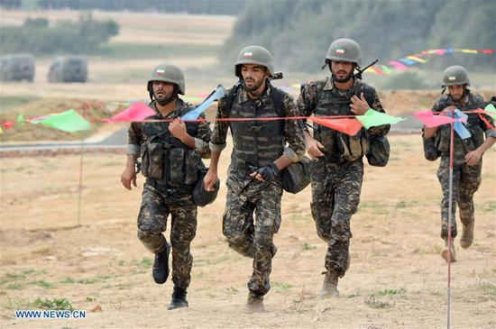 Iranian team members participate in the survival trail event of the International Army Games 2018