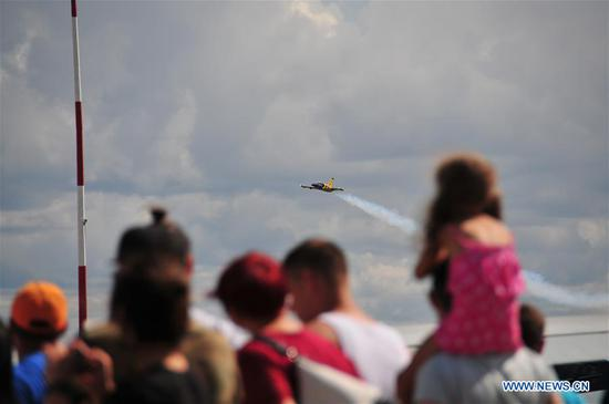 People watch the Wings Over Baltics Air Show at Jurmala Airport, Tukums, Latvia, Aug. 5, 2018. An international air show Wings Over Baltics was held here from Aug. 4 to Aug. 5, attracting thousands of visitors. (Xinhua/Janis)