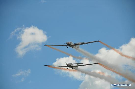 Aircraft of British Aerosparx Team perform during the Wings Over Baltics Air Show at Jurmala Airport, Tukums, Latvia, Aug. 5, 2018. An international air show Wings Over Baltics was held here from Aug. 4 to Aug. 5, attracting thousands of visitors. (Xinhua/Janis)