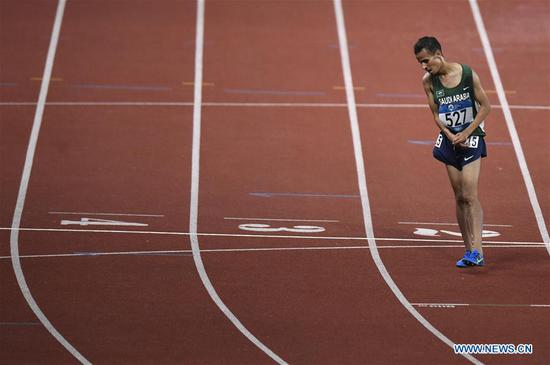 Tariq Ahmed Alamri of Saudi Arabia reacts during men's 5000m final of athletics at the 18th Asian Games in Jakarta, Indonesia on Aug. 30, 2018. (Xinhua/Huang Zongzhi)