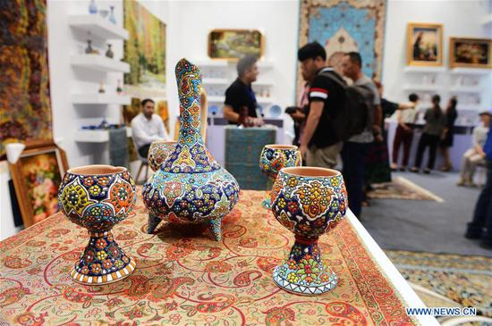 """Photo taken on Aug. 30, 2018 shows exhibits at the sixth China-Eurasia Expo in Urumqi, northwest China's Xinjiang Uygur Autonomous Region. The three-day international fair opened Thursday in Urumqi under the theme of """"The Belt and Road -- Wide Discussion, Joint Contribution and Shared Benefits"""". (Xinhua/Sadat)"""