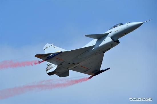 A J-10B fighter jet performs an aerobatics display during the 12th China International Aviation and Aerospace Exhibition (Airshow China) in Zhuhai, south China's Guangdong Province, on Nov. 6, 2018. A J-10B thrust-vectoring demonstrator made its debut at Airshow China, which opened Tuesday in Zhuhai. (Xinhua/Liang Xu)