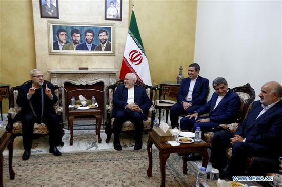 Iranian Foreign Minister Mohammad Javad Zarif (2nd L) meets with Lebanese officials in the Iranian Embassy in Beirut, Lebanon, on Feb. 10, 2019. Zarif arrived in Lebanon on Sunday for a two-day official visit to meet with Lebanese officials and informed them about Iran's readiness to help Lebanon on all levels. (Xinhua/Bilal Jawich)