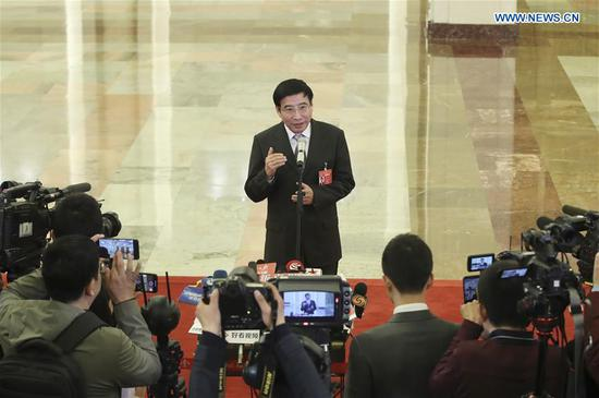 Minister of Industry and Information Technology Miao Wei receives an interview after the opening meeting of the second session of the 13th National People's Congress at the Great Hall of the People in Beijing, capital of China, March 5, 2019. (Xinhua/Yin Gang)