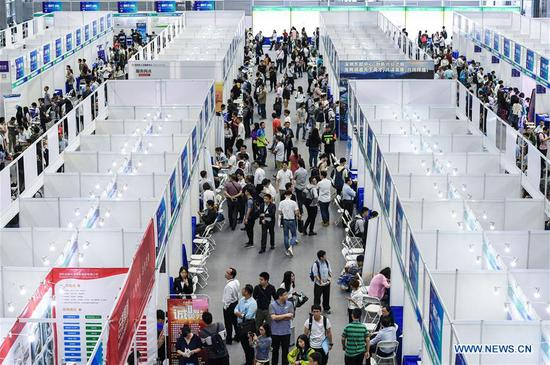 Photo taken on April 14, 2019 shows a job fair during the 17th Conference on International Exchange of Professionals (CIEP) in Shenzhen, south China's Guangdong Province. The conference kicked off in Shenzhen on Sunday, attracting about 4,000 agencies and organizations from more than 50 countries and regions, as well as 40,000 government representatives, experts and high talented people. (Xinhua/Mao Siqian)