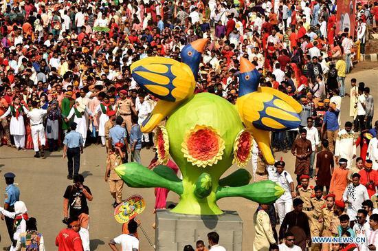 People celebrate the Bengali New Year of 1426 in Dhaka, Bangladesh on April 14, 2019. (Xinhua/Salim Reza)
