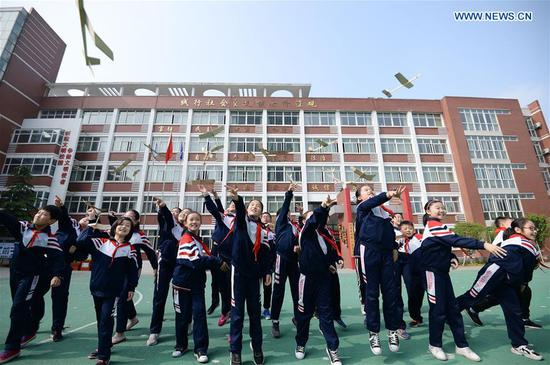 Students of Hanshan District Experimental Primary School fly model planes they made in Handan City, north China's Hebei Province, April 24, 2019. Since 2016, China has set April 24 as the country's Space Day. The various activities on Space Day have become a window for the Chinese public and the world to get a better understanding of China's aerospace progress. (Xinhua/Hao Qunying)