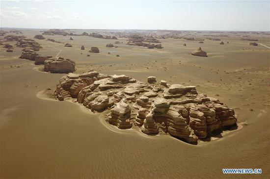 Aerial photo taken on May 8, 2019 shows the scenery of Dunhuang Yardang National Geopark after a rain in Dunhuang, northwest China's Gansu Province. (Xinhua/Fan Peishen)
