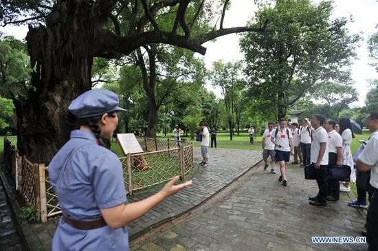 Journalists conduct a group interview during an activity to retrace the route of the Long March at a revolutionary site in Ruijin City, east China's Jiangxi Province, June 11, 2019. The activity is aimed at paying tribute to the revolutionary martyrs and passing on the traditions of revolution, as the country celebrates the 70th anniversary of the founding of the People's Republic of China this year. Over 500 journalists from more than 30 media outlets across the country attended the ceremonies. The Long March was a military maneuver carried out by the Chinese Workers' and Peasants' Red Army from 1934 to 1936. During this period, they left their bases and marched through rivers, mountains and arid grassland to break the siege of Kuomintang forces and continue to fight Japanese aggressors. Many marched as far as 12,500 km. (Xinhua/Li Renzi)