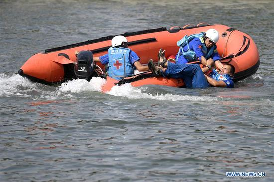 Members of Blue Sky Rescue take part in a rescue drill to mark the Maritime Day of China on the Haihe River in north China's Tianjin, July 11, 2019. The Maritime Day of China falls on July 11 every year. (Xinhua/Yue Yuewei)