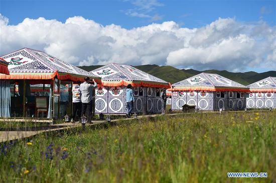 Tourists visit a tent scenic spot at Gaxiu Village of Gahai Township, Luqu County, Gannan Tibetan Autonomous Prefecture, northwest China's Gansu Province, Aug. 13, 2019. In recent years, Gannan promoted culture and tourism industry to boost income of local people. (Xinhua/Zhao Dingzhe)