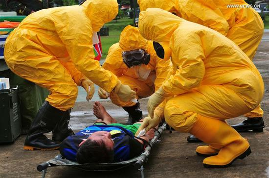 Participants take part in the comprehensive epidemic prevention and control drills during the
