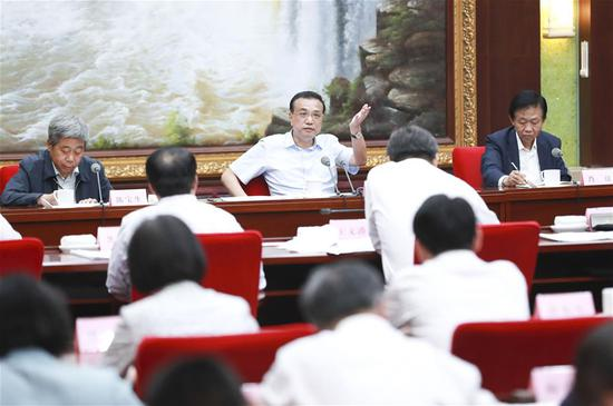 Chinese Premier Li Keqiang, also a member of the Standing Committee of the Political Bureau of the Communist Party of China (CPC) Central Committee, presides over a symposium on stabilizing employment in Harbin, capital of northeast China's Heilongjiang Province, Aug. 19, 2019. (Xinhua/Pang Xinglei)