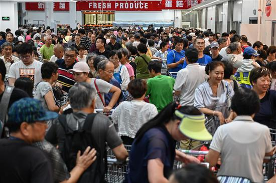 People visit the first Costco outlet in China, on the stores opening day in Shanghai on August 27, 2019.
