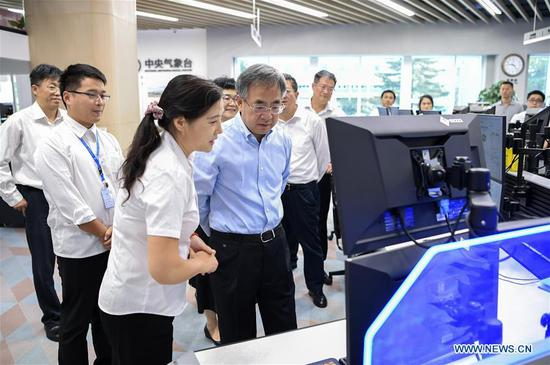 Chinese Vice Premier Hu Chunhua, also a member of the Political Bureau of the Communist Party of China Central Committee, stresses meteorological support to ensure the success of the activities to celebrate the 70th anniversary of the founding of the People's Republic of China (PRC) while inspecting the China Meteorological Administration in Beijng, capital of China, Sept. 19, 2019. (Xinhua/Zhang Ling)