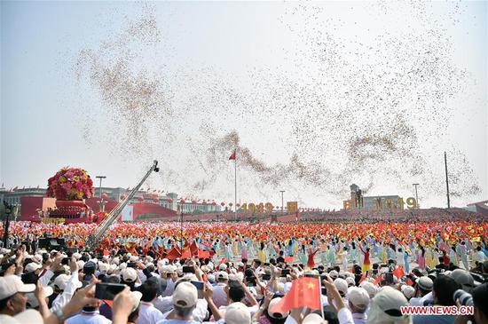 People take part in a mass pageantry celebrating the 70th anniversary of the founding of the People's Republic of China (PRC) in Beijing, capital of China, Oct. 1, 2019. (Xinhua/Chen Jianli)