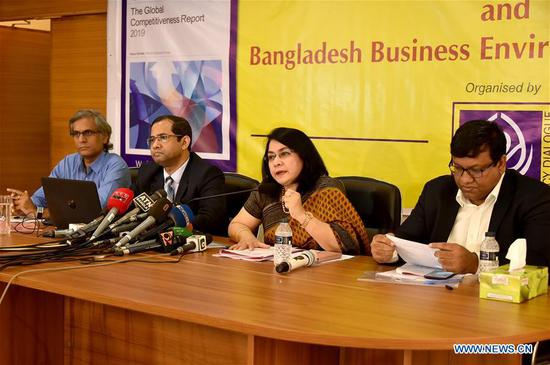 Fahmida Khatun (2nd R), Executive Director of the Centre for Policy Dialogue (CPD), speaks during a press briefing in Dhaka, Bangladesh, on Oct. 9, 2019. Bangladesh has slipped two positions to rank 105th out of 141 surveyed economies in the 2019 annual global competitiveness. A leading Bangladeshi think-tank, the Centre for Policy Dialogue (CPD), unveiled a report on behalf of the Geneva-based World Economic Forum (WEF) at the press briefing in Dhaka on Wednesday. (Str/Xinhua)