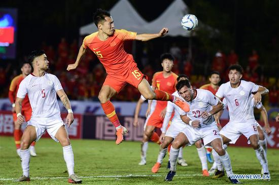 Wu Xi (Top) of China heads for the ball during the group A match against the Philippines at the FIFA World Cup Qatar 2022 and AFC Asian Cup China 2023 Preliminary Joint Qualification Round 2 in Bacolod, the Philippines, Oct. 15, 2019. (Xinhua/Du Yu)
