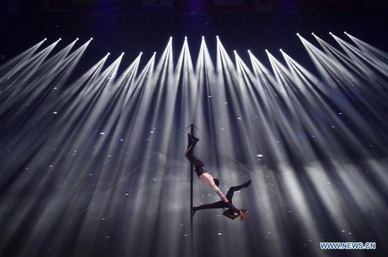 Two acrobats from Russia and Moldova perform during the 17th China Wuqiao International Circus Festival in Cangzhou, north China's Hebei Peovince, Nov. 7, 2019. The 17th China Wuqiao International Circus Festival concluded here on Thursday. Founded in 1987, the biennial festival is regarded as China's longest-running international circus festival, while boasting a wide influence in the field of acrobatics. (Xinhua/Mu Yu)