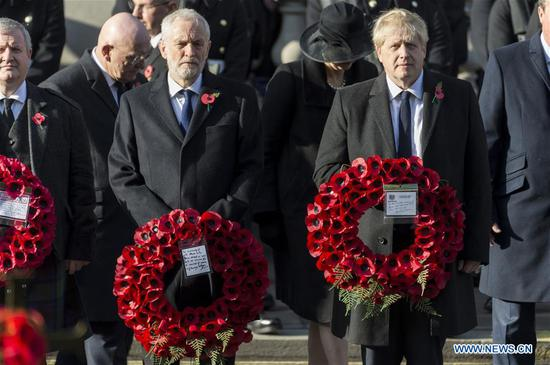 British Prime Minister Boris Johnson (R, Front) and British Labour Party Leader Jeremy Corbyn (C, Front) attend the Remembrance Sunday Service in London, Britain, on Nov. 10, 2019. The Remembrance Sunday ceremony is an annual event to pay tribute to the war dead of Britain and the Commonwealth, which is held on the nearest Sunday to the anniversary of the end of World War I on Nov. 11, 1918. (Photo by Ray Tang/Xinhua)