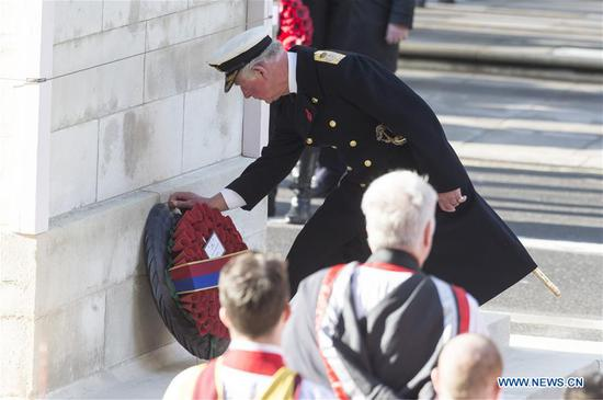 Britain's Prince Charles, Prince of Wales, lays a wreath during the Remembrance Sunday Service in London, Britain, on Nov. 10, 2019. The Remembrance Sunday ceremony is an annual event to pay tribute to the war dead of Britain and the Commonwealth, which is held on the nearest Sunday to the anniversary of the end of World War I on Nov. 11, 1918. (Photo by Ray Tang/Xinhua)