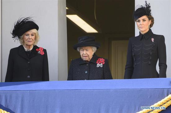 Camilla, Duchess of Cornwall (L), Queen Elizabeth II (C) and Catherine, Duchess of Cambridge, attend the Remembrance Sunday Service in London, Britain, on Nov. 10, 2019. The Remembrance Sunday ceremony is an annual event to pay tribute to the war dead of Britain and the Commonwealth, which is held on the nearest Sunday to the anniversary of the end of World War I on Nov. 11, 1918. (Photo by Ray Tang/Xinhua)