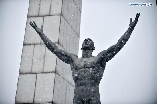 A sculpture is seen in snow at a square in Changchun, capital of northeast China's Jilin Province, Nov. 13, 2019. A snowfall hit Changchun on Wednesday. (Xinhua/Yan Linyun)