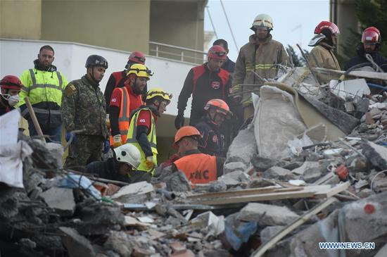 Rescuers work at the site of a collapsed building in the town of Durres, Albania, on Nov. 27, 2019. The death toll of the disastrous earthquake which hit Albania on Tuesday morning climbed to 21, and rescuers continued hunt for survivors, authorities said on Tuesday evening. (Xinhua/Zhang Liyun)