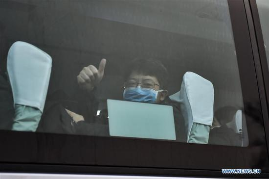 A Medical worker heads for Wuhan City of Hubei in Beijing, Capital of China, Jan. 27, 2020. A team comprised of 136 medical workers from Beijing left for Wuhan City on Monday to aid the novel coronavirus control efforts there. (Xinhua/Peng Ziyang)