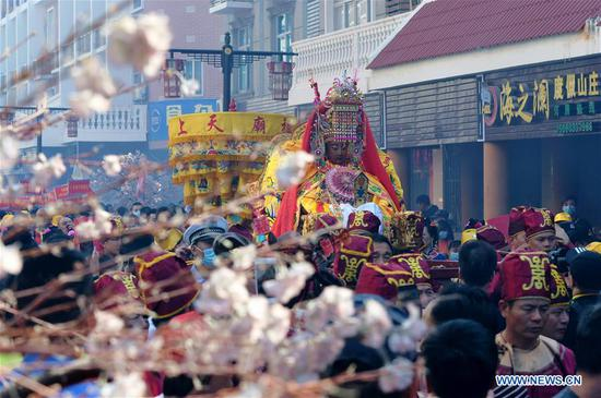 A statue of the Chinese sea goddess Mazu is in a parade around the Meizhou Island in Putian City, southeast China's Fujian Province, Oct. 25, 2020. In 2009, the Mazu belief and customs were inscribed on the UNESCO Representative List of the Intangible Cultural Heritage of Humanity. (Xinhua/Wei Peiquan)