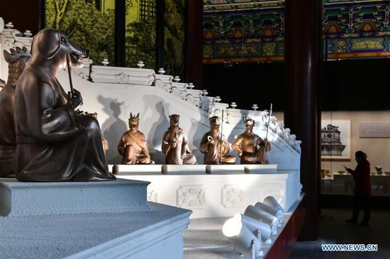 A replica of the fountain clock, to which the 12 zodiac animal head statues looted from Yuanmingyuan originally belonged, is on display at an exhibition themed on the return of a looted bronze horse head in Beijing, capital of China, Dec. 1, 2020. A bronze horse head sculpture, a treasure of China's Old Summer Palace that went missing after an Anglo-French allied forces' looting 160 years ago, returned to its original palace home Tuesday. It is the first time that a lost important cultural relic from the Old Summer Palace, or