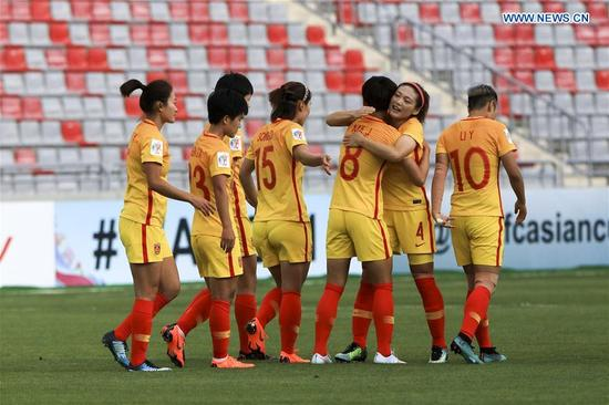 China's Ma Jun (3rd R) celebrates scoring with teammates during the group A match between China and the Philippines at the 2018 AFC Women's Asian Cup, in Amman, Jordan, April 9, 2018. (Xinhua/Mohammmad Abu Ghosh)