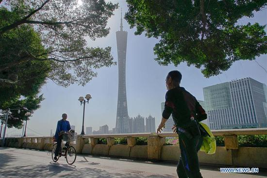 People walk on a path in Ersha Island of Guangzhou, south China's Guangdong Province, capital of on April 8, 2018 . (Xinhua/Cai Yang)