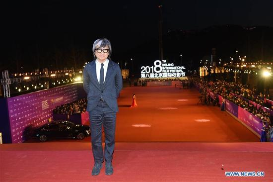 Peter Chan poses on the red carpet before the opening ceremony of the 8th Beijing International Film Festival (BJIFF) in Beijing, capital of China, April 15, 2018. (Xinhua/Luo Xiaoguang)