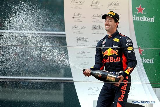 Red Bull's driver Daniel Ricciardo of Australia sprays champagne to celebrate on the podium after winning the Formula One Chinese Grand Prix in Shanghai, east China, April 15, 2018. Daniel Ricciardo claimed the title of the event in 1 hour, 35 minutes and 36.380 seconds. (Xinhua/Fan Jun)