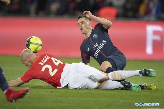 Giovani Lo Celso (R) from Paris Saint-Germain competes with Andrea Raggi from Monaco during their match of French Ligue 1 2017-18 season 33rd round in Paris, France on April 15, 2018. Paris Saint-Germain won Monaco with 7-1 at home and won the championship. (Xinhua/Jack Chan)