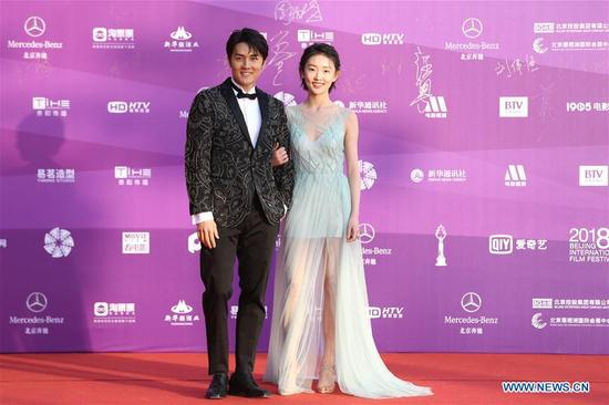Guests pose on the red carpet before the opening ceremony of the 8th Beijing International Film Festival (BJIFF) in Beijing, capital of China, April 15, 2018. (Xinhua/Cai Yang)