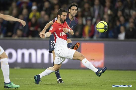Javier Pastore (Rear) from Paris Saint-Germain competes with Joao Moutinho from Monaco during their match of French Ligue 1 2017-18 season 33rd round in Paris, France on April 15, 2018. Paris Saint-Germain won Monaco with 7-1 at home and won the championship. (Xinhua/Jack Chan)