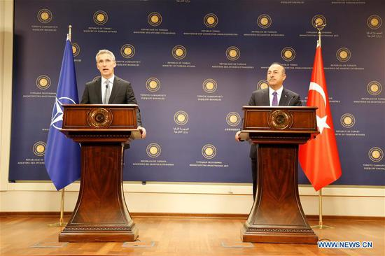 Turkish Foreign Minister Mevlut Cavusoglu (R) and NATO Secretary General Jens Stoltenberg attend a joint press conference in Ankara, Turkey, on April 16, 2018. (Xinhua/Qin Yanyang)
