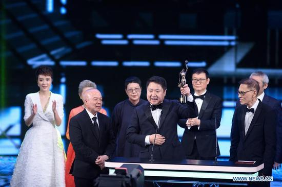 Yu Dong (C, front), CEO of Bona Film Group, poses during the 37th Hong Kong Film Awards presentation ceremony in Hong Kong, south China, April 15, 2018. The film