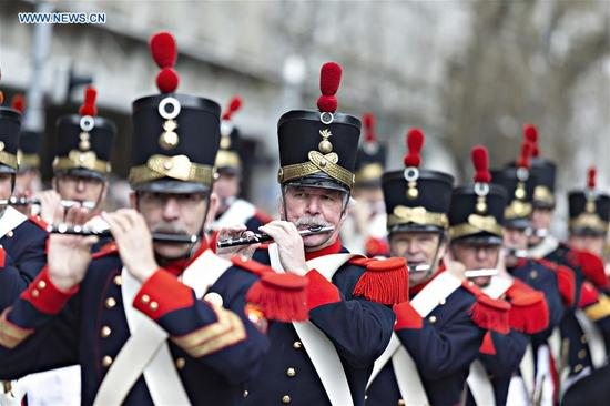 People take part in a parade during the Sechselauten, a local Spring festival, in Zurich, Switzerland, on April 16, 2018. The Sechselauten is a traditional festival marking the end of winter with a parade of guilds in historical costumes and the burning of a symbolic snowman. (Xinhua/Michele Limina)