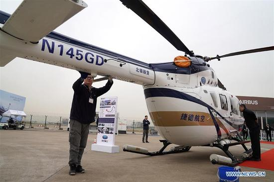 An exhibitor cleans an airplane for the Asian Business Aviation Conference and Exhibition (ABACE) at Shanghai Hongqiao International Airport in east China's Shanghai, April 16, 2018. The ABACE is expected to be held here from April 17 to 19, attracting over 170 companies around the world to participate in the exhibition. (Xinhua/Chen Fei)