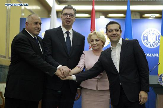 Bulgarian Prime Minister Boiko Borisov, Serbian President Aleksandar Vucic, Romanian Prime Minister Viorica Dancila, and Greek Prime Minister Alexis Tsipras (from L to R) pose for photos at a joint press conference at Victoria Palace in Bucharest, Romania, April 24, 2018. The leaders of Romania, Bulgaria, Greece and Serbia met here on Tuesday, discussing economic cooperation, concrete projects and the 16+1 cooperation format promoted by China. (Xinhua/Cristian Cristel)