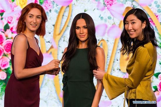 Visitors view a new wax figure of Meghan Markle at Madame Tussauds in London, Britain on May 19, 2018. A new wax figure of Meghan Markle was unveiled ahead of her wedding to Prince Harry on May 19 at Madame Tussauds London on Wednesday. (Xinhua/Ray Tang)