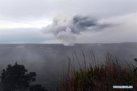 Ash emission is seen erupting from Halemaumau of Kilauea volcano on the Hawaii Island, the United States, on May 10, 2018. As the potential for