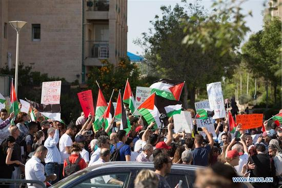 People protest against the new U.S. embassy in Jerusalem, on May 14, 2018. The inauguration ceremony of the new U.S. embassy in Jerusalem started on Monday afternoon, as Israeli and U.S. officials gathered in the city amidst deadly clashes in the Gaza Strip. (Xinhua/Guo Yu)