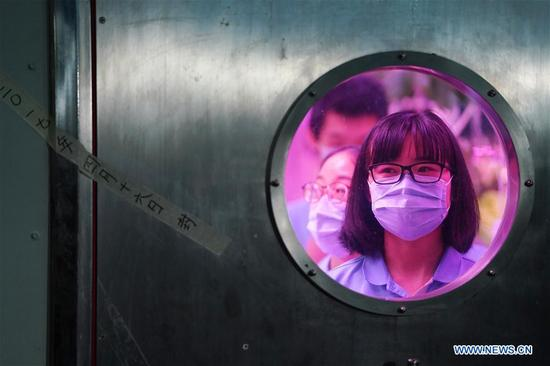 Volunteer Liu Hui prepares to leave the Yuegong-1, or Lunar Palace 1, at Beihang University in Beijing, capital of China, May 15, 2018. Chinese volunteers have completed a one-year test living in a simulated space lab in Beijing, setting a new record for the longest stay in a self-contained cabin. The total length of the test, which started on May 10th last year, reached 370 days, with the third stage accounting for 110 days. Liu Hong, chief designer of Yuegong-1, said the test marks the longest stay in a bioregenerative life support system (BLSS), in which humans, animals, plants and microorganisms co-exist in a closed environment, simulating a lunar base. (Xinhua/Ju Huanzong)