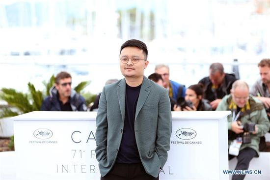 Director Bi Gan attends the photocall for