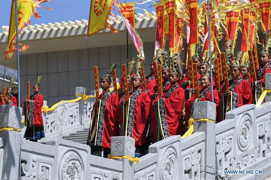 Actors perform during an ancestor worship grand ceremony in honor of Emperor Yao, a legendary Chinese ruler, in Linfen, north China's Shanxi Province, June 11, 2018. (Xinhua/Yang Chenguang)