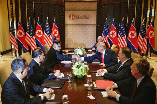 Top leader of the Democratic People's Republic of Korea (DPRK) Kim Jong Un (3rd L) holds talks with U.S. President Donald Trump (3rd R) in Singapore, on June 12, 2018. (Xinhua/Ministry of Communication and Information of Singapore)